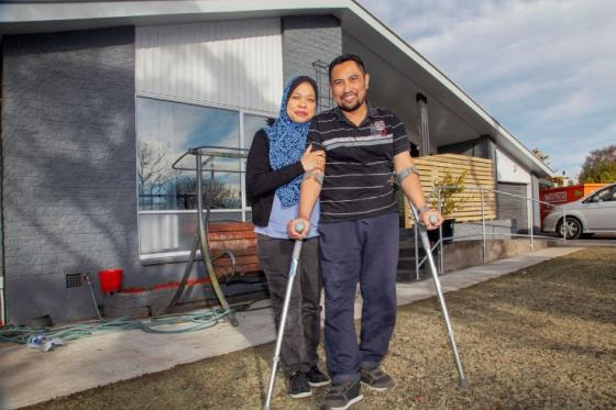 Rahimi Ahmad and wife outside their new home