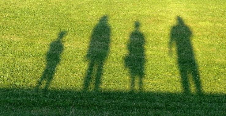 Shadow of a family outside in the sun